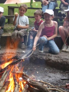 Girl toasting marshmallow over a fire