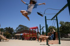 girl jumping off swing