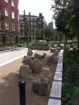 Pedestrian street with boulders, EC1