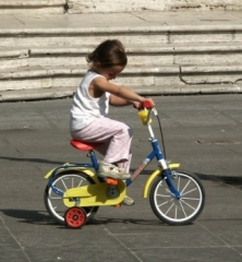 Girl on a yellow bike