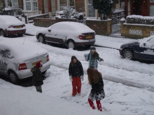 Four children playing in a snowy street
