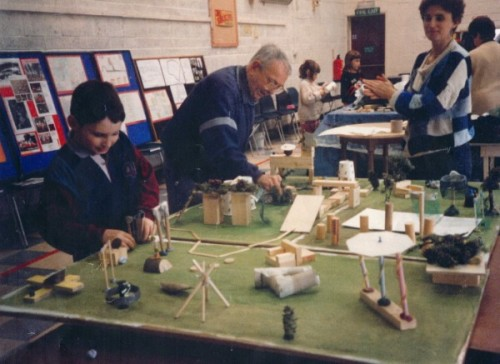Children making models of play equipment