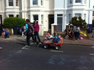 Man pulling children in trailer