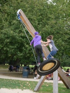 Two children on tyre swing
