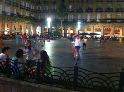 Children playing at Plaza Nueva after dark