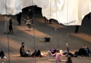 People on swings at event of a thread
