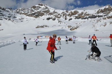 RCMP mountie playing hockey in the mountains