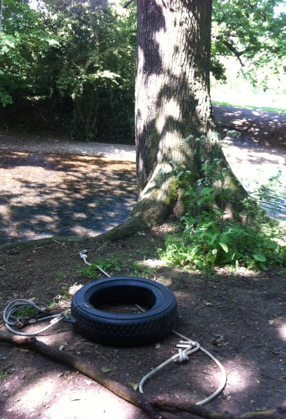 Tyre swing on ground