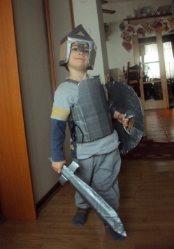 Boy with cardboard and duct tape suit of armour