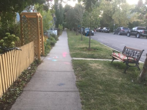 Front yard and bench with sidewalk chalk, Sunnyside, Calgary