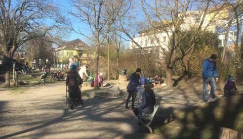 Families enjoying a green space in Vauban, Freiburg, March 2018