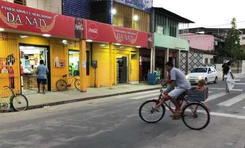 Man and two children on a bicycle in Iputinga neighbourhood, Recife