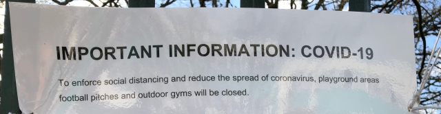 Cropped 'Park closed' sign outside park in Waltham Forest