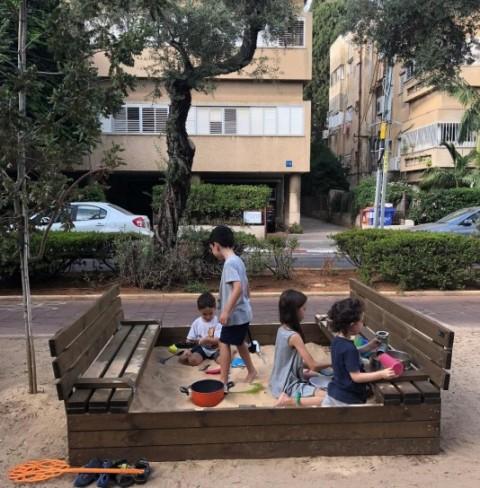 Movable sandbox outside community centre. Photo: Bosmat Sfadia Wolf.
